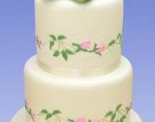 Rose Wedding - Our Entwined Roses (side designs) and Grandiflora (cake topper) decorate this simple but beautiful wedding cake.